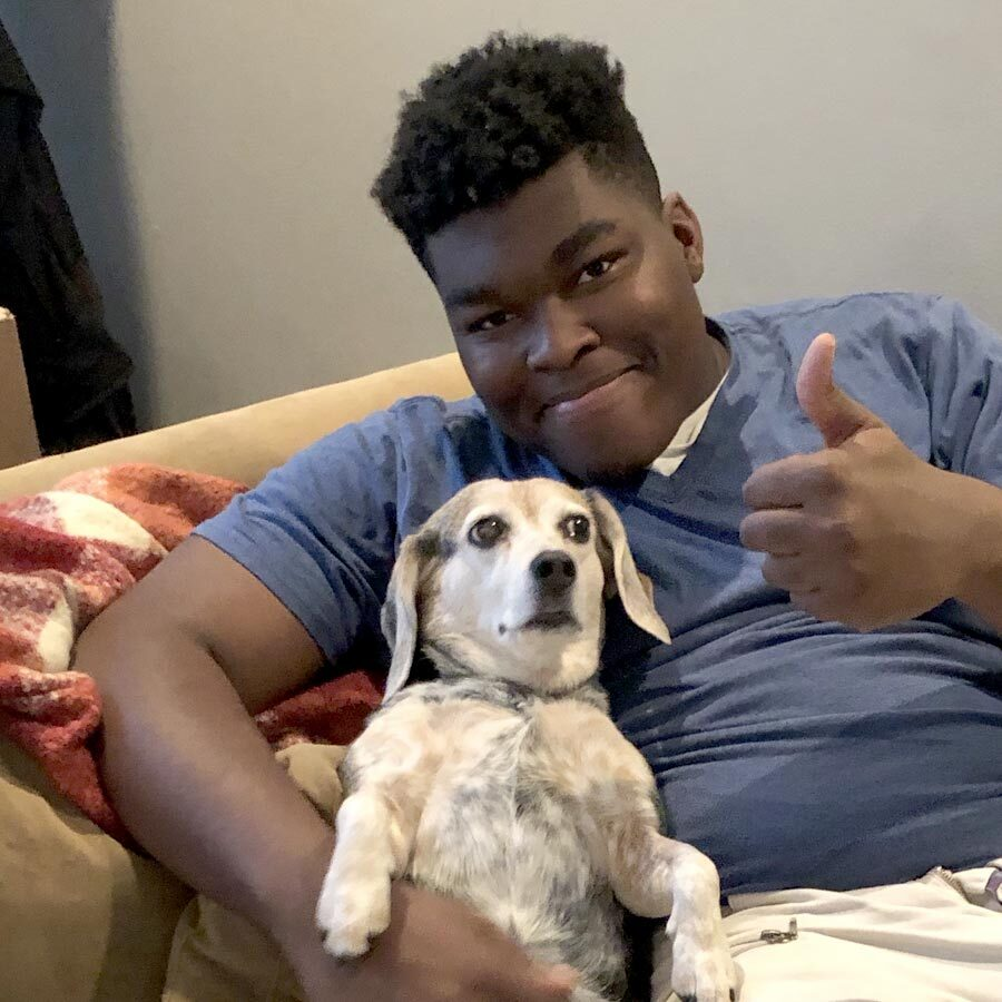 Individual holding a dog